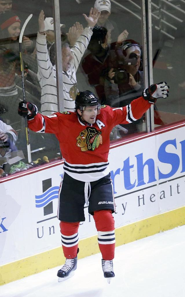 Chicago Blackhawks left wing Patrick Sharp celebrates his goal during the first period of an NHL hockey game against the Colorado Avalanche, Friday, Dec. 27, 2013, in Chicago. (AP Photo/Charles Rex Arbogast)