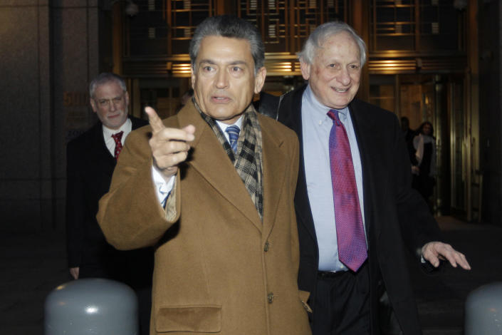 FILE- In this Jan. 5, 2012 file photo, former Goldman Sachs board member Rajat Gupta, left, exits Manhattan federal court with his attorney Gary Naftalis, in New York. The insider trading trial of the former board member for Goldman Sachs and Procter & Gamble begins in New York on Monday, May 21, 2012, with jury selection. (AP Photo/Mary Altaffer, File)
