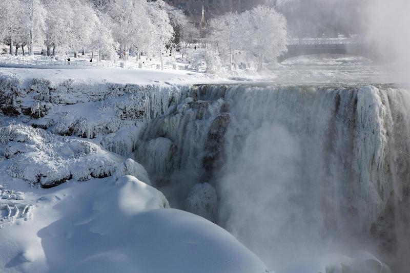 People walk in a park on the US side of the Niagara Falls on January 31, 2019 (AFP Photo/Lars Hagberg)