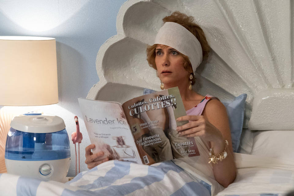 """This image released by Lionsgate shows Kristen Wiig in """"Barb and Star Go to Vista Del Mar."""" (Cate Cameron/Lionsgate via AP)"""