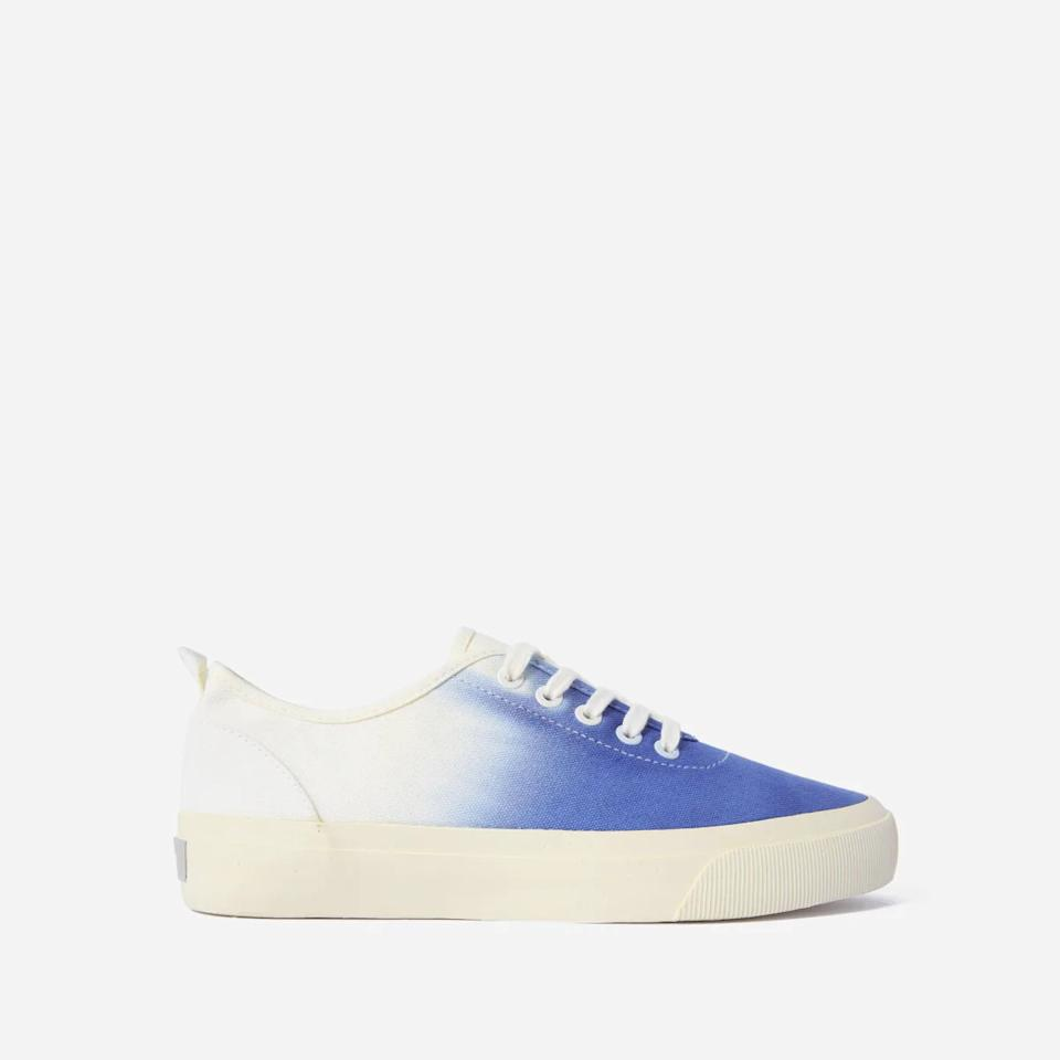 The Forever Sneaker in white with blue dip. Image via Everlane.