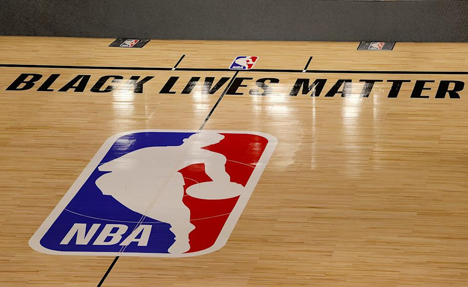 The Black Lives Matter logo is seen on an empty court as all NBA playoff games were postponed today during the 2020 NBA Playoffs at AdventHealth Arena.
