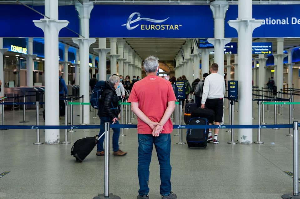 Travellers boarding the train in St Pancras International in London, Britain, 10 July 2020. English holidaymakers will be able to visit Spain, Italy, France and Germany without having to quarantine for 14 days on their return. (Photo by Maciek Musialek/NurPhoto via Getty Images)