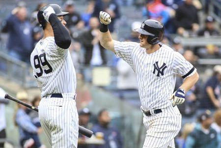 Apr 20, 2019; Bronx, NY, USA; New York Yankees center fielder Mike Tauchman (39) is greeted by right fielder Aaron Judge (99) after hitting a three run home run in the fourth inning against the Kansas City Royals at Yankee Stadium. Mandatory Credit: Wendell Cruz-USA TODAY Sports