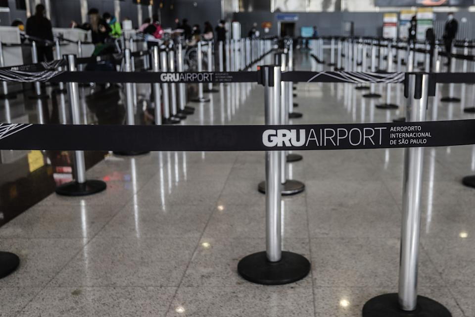 SAO PAULO, May 25, 2020 -- Few passengers are seen at the check-in area of Guarulhos International Airport on the outskirts of Sao Paulo, Brazil, May 25, 2020. Brazil on Monday said its death toll from the novel coronavirus climbed to 23,473, following 807 fatalities in a single day.     The total number of people who have tested positive for the disease reached 374,898, with a mortality rate of 6.3 percent, according to the Health Ministry. (Photo by Rahel Patrasso/Xinhua via Getty) (Xinhua/ via Getty Images)