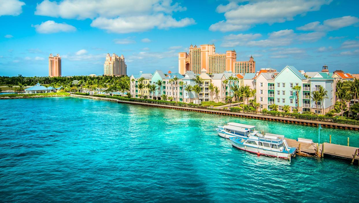 Skyline of Paradise Island with colorful houses at the ferry terminal. Nassau, Bahamas.