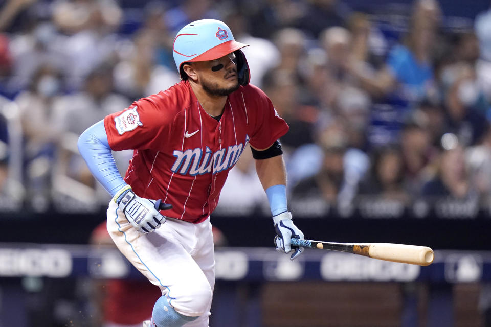 Miami Marlins' Miguel Rojas runs after hitting a single during the fourth inning of a baseball game against the New York Yankees, Saturday, July 31, 2021, in Miami. (AP Photo/Lynne Sladky)