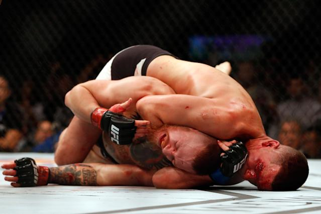 <p>McGregor was supposed to be fighting Rafael dos Anjos for the lightweight title in this bout just four months after knocking out Jose Aldo to win the featherweight title. However, dos Anjos was injured and Diaz stepped in as a late replacement. Because he had been on vacation and not training at the time he was called, the UFC made the fight at welterweight. The promotion was vitriolic as both men exchanged nasty taunts. McGregor started well, but faded and was unable to defend against Diaz's jiu-jitsu. He was forced to tap to a rear naked choke. </p>