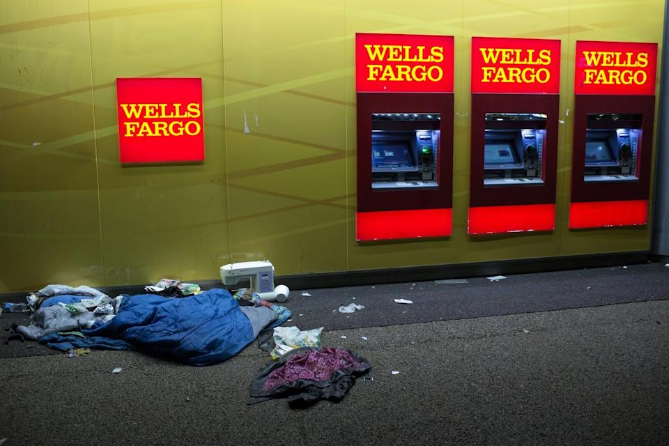 A homeless person's belongings lie on the sidewalk next to a Wells Fargo Bank branch in Los Angeles