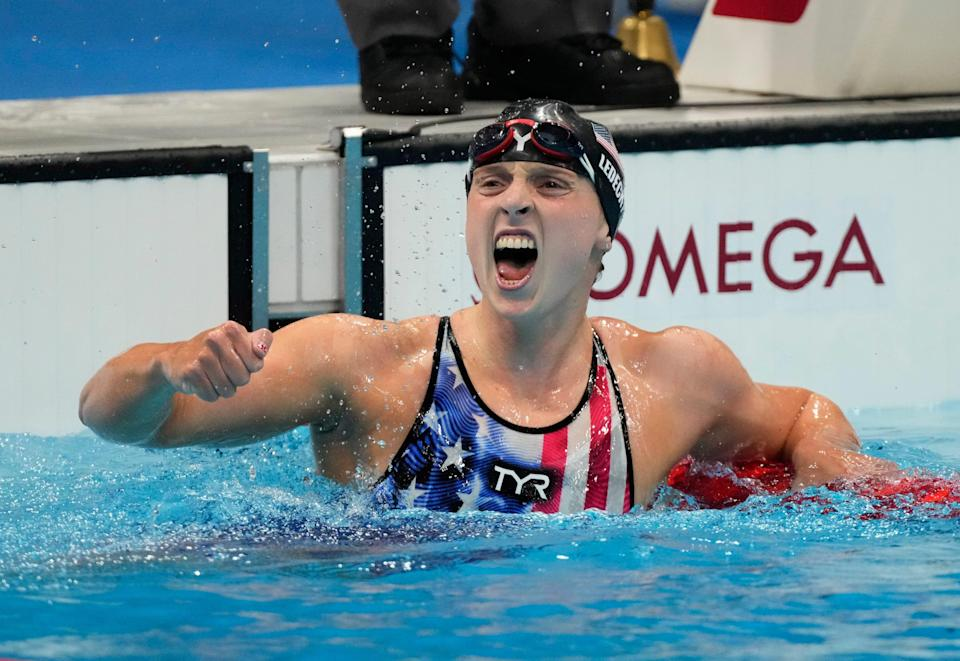 Katie Ledecky celebrates after winning the women's 1500m freestyle final during the Tokyo 2020 Olympic Summer Games..