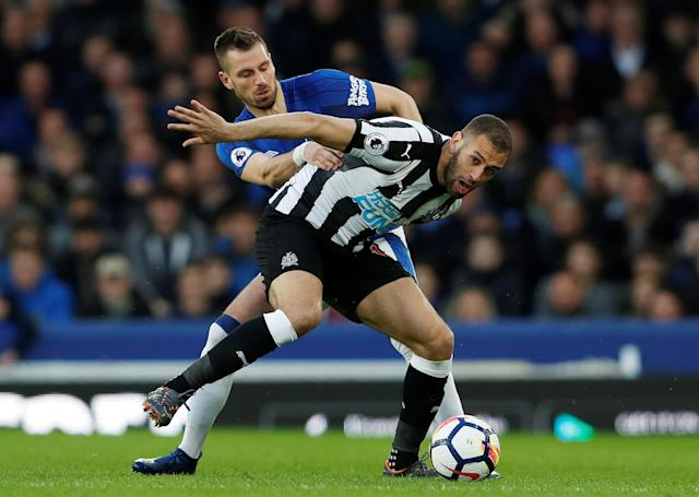 "Soccer Football - Premier League - Everton v Newcastle United - Goodison Park, Liverpool, Britain - April 23, 2018 Newcastle United's Islam Slimani in action with Everton's Morgan Schneiderlin Action Images via Reuters/Lee Smith EDITORIAL USE ONLY. No use with unauthorized audio, video, data, fixture lists, club/league logos or ""live"" services. Online in-match use limited to 75 images, no video emulation. No use in betting, games or single club/league/player publications. Please contact your account representative for further details."