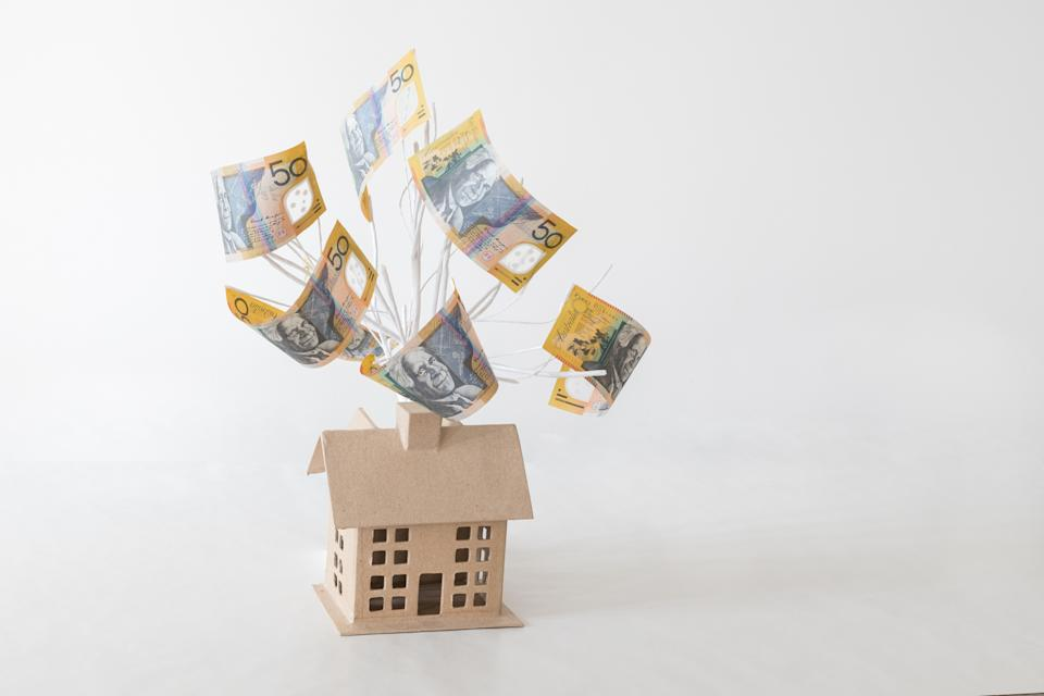 Pictured: Investment property concept, Australian house with money growing out of it. Image: Getty