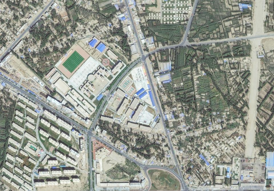 RE-EDUCATION INTERNMENT CAMP, WESTERN CHINA -- SEPTEMBER 20, 2018:  Maxar satellite imagery of a re-education internment camp in Hotan, Xinjiang, China for the purpose of indoctrinating Uyghurs since 2017.  Please use: Satellite image (c) 2019 Maxar Technologies.