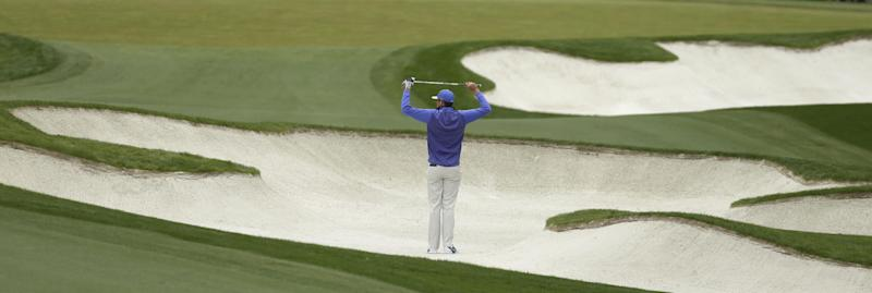 Nick Watney stretches before hitting his shot on the first hole during the third round of the Wells Fargo Championship golf tournament at Quail Hollow Club in Charlotte, N.C., Saturday, May 4, 2013. (AP Photo/Chuck Burton)