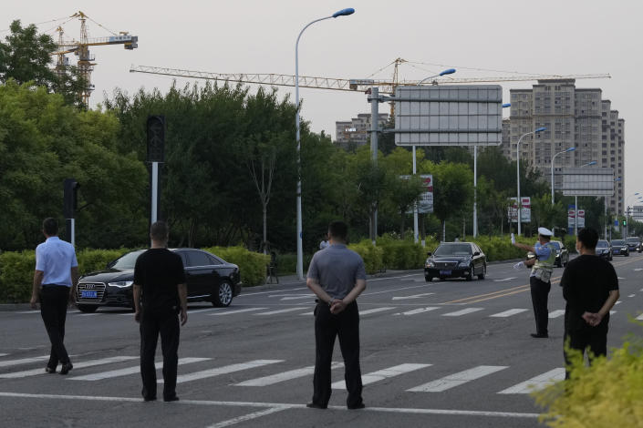 """A car with a sign which reads """"Special transport for Foreign Affairs Reception"""", center is seen ahead of a convoy of cars that is believed to include U.S. deputy secretary Wendy Sherman as they prepare to enter the Tianjin Binhai No. 1 Hotel where U.S. and Chinese officials are expected to meet in Tianjin municipality in China on Sunday, July 25, 2021. Deputy Secretary of State Wendy Sherman travelled to China this weekend on a visit that comes as tensions between Washington and Beijing soar on multiple fronts, the State Department said Wednesday. (AP Photo/Ng Han Guan)"""