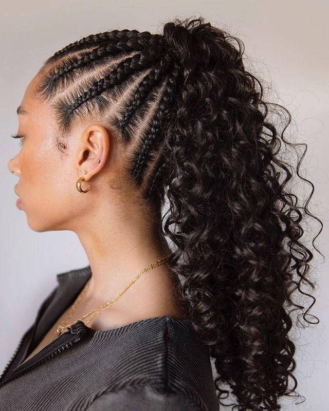 """<p>Dress up a simple ponytail with a cornrowed updo. You can cheat this curly ponytail with an easy clip-in like <a href=""""https://www.spellbeauty.com/collections/instant-pony/products/ocean-wave?variant=28183567335508"""" rel=""""nofollow noopener"""" target=""""_blank"""" data-ylk=""""slk:this one from Spell Beauty, £11.99."""" class=""""link rapid-noclick-resp"""">this one from Spell Beauty, £11.99.</a></p><p><a href=""""https://www.instagram.com/p/CBTzDI4AVR_/"""" rel=""""nofollow noopener"""" target=""""_blank"""" data-ylk=""""slk:See the original post on Instagram"""" class=""""link rapid-noclick-resp"""">See the original post on Instagram</a></p>"""