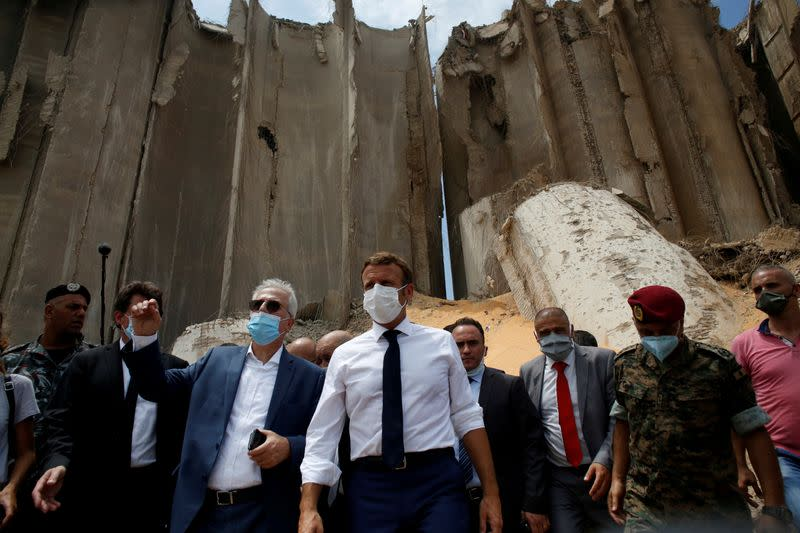 FILE PHOTO: French President Emmanuel Macron gestures as he visits the devastated site of the explosion at the port of Beirut