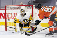 Philadelphia Flyers' Joel Farabee, right, scores a goal on Pittsburgh Penguins goaltender Tristan Jarry during the second period of an NHL hockey game Wednesday, Jan. 13, 2021, in Philadelphia. (AP Photo/Chris Szagola)