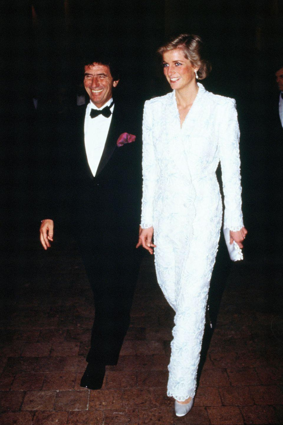 <p>In a white suit by Catherine Walker at a dinner at Chateau de Chambord during an official visit to France. </p>