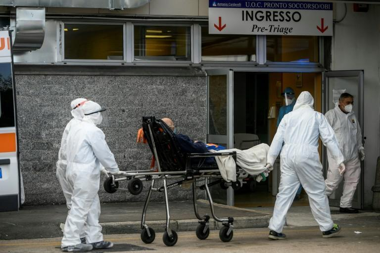 Another patient is brought into the emergency department of the Cardarelli hospital in Naples amid a surge of virus cases