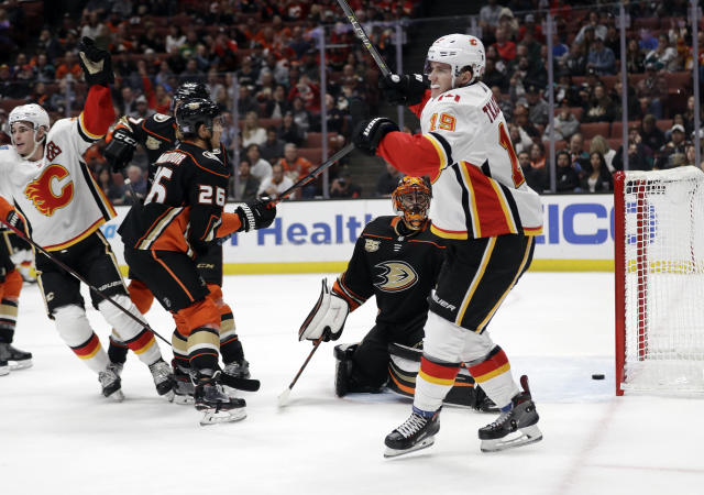 Calgary Flames' Matthew Tkachuk, right, celebrates his goal against the Anaheim Ducks during the first period of an NHL hockey game Wednesday, Nov. 7, 2018, in Anaheim, Calif. (AP Photo/Marcio Jose Sanchez)