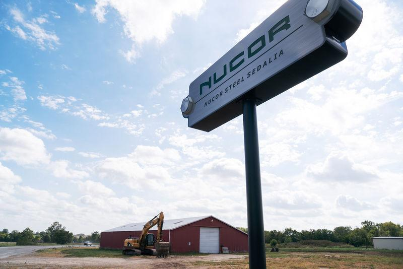 A sign for the Nucor Steel Mill, under construction, is seen in Sedalia