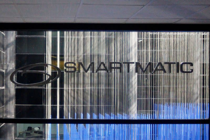 FILE PHOTO: The corporate logo of Smartmatic is seen at its offices in Caracas