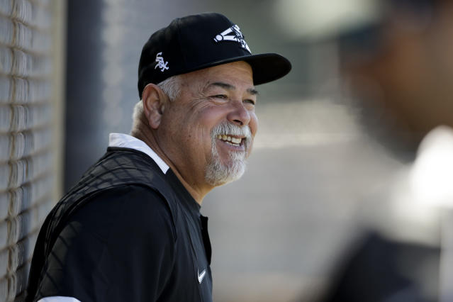 Chicago White Sox manager Rick Renteria smiles during spring training baseball Saturday, Feb. 15, 2020, in Phoenix. (AP Photo/Gregory Bull)