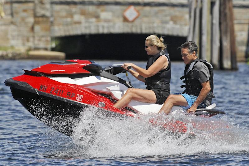 "FILE - In this July 2, 2012, photo Republican presidential candidate Mitt Romney, and wife Ann Romney jet ski on Lake Winnipesaukee in Wolfeboro, N.H. Romney's large family is at the center of his life _ and of his presidential campaign. At a time when nontraditional families have become the norm _ and when even the Romneys are watching ""Modern Family,"" a popular sitcom that centers on unconventional family arrangements _ the Romney brood stands out. (AP Photo/Charles Dharapak, File)"