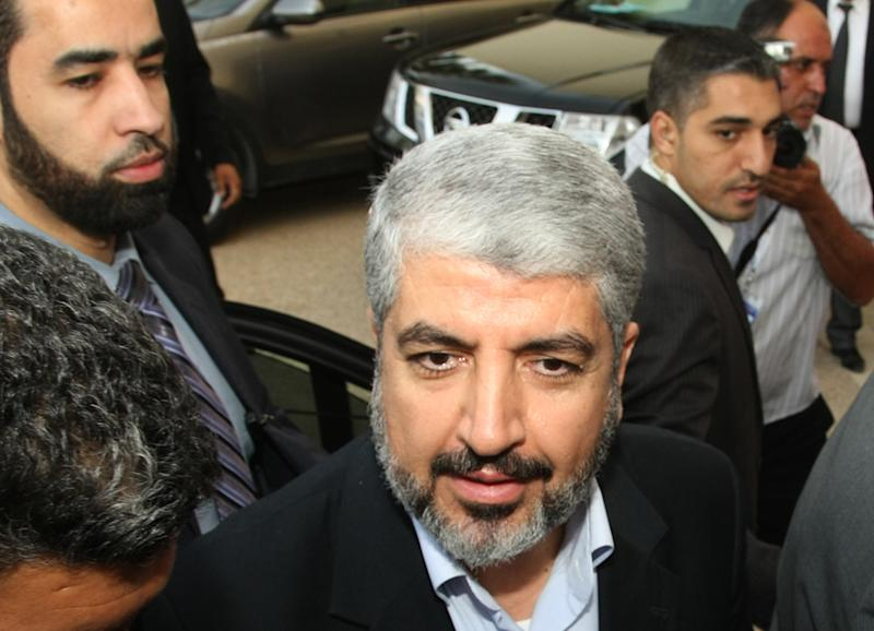 FILE - In this Thursday, July 12, 2012 file photo, Hamas leader Khaled Mashaal arrives at the Islamist Ennahda party congress in Tunis. The leader of Gaza's ruling Hamas group will visit the Palestinian territory for the first time, an official said Saturday, Dec. 1, 2012, a sign of increasing boldness of the Islamic militant movement after it held its own against an Israeli military offensive. Khaled Mashaal was set to arrive in the Gaza Strip next week by crossing the border from Egypt to mark Hamas' 25th anniversary and congratulate its leaders and fighters for battling Israel during the recent eight-day offensive, according to a senior Hamas official in Gaza.  (AP Photo/Amine Landoulsi, File)