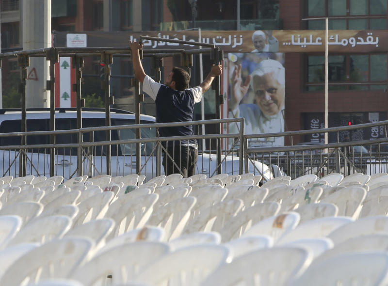 A worker sets a small stage in preparation of the area where the Pope Benedict XVI will hold a Holy mass on September 16 during his visit to Lebanon, at the waterfront of downtown Beirut, Wednesday Sept. 12, 2012. Pope Benedict XVI travels to Lebanon to encourage his flock in the Middle East. He will also meet with Lebanese authorities as well as Christians from Lebanon and other nearby countries. (AP Photo/Hussein Malla)
