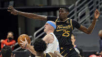 Los Angeles Lakers guard Alex Caruso (4) drive past Toronto Raptors forward Chris Boucher (25) during the second half of an NBA basketball game Tuesday, April 6, 2021, in Tampa, Fla. (AP Photo/Chris O'Meara)