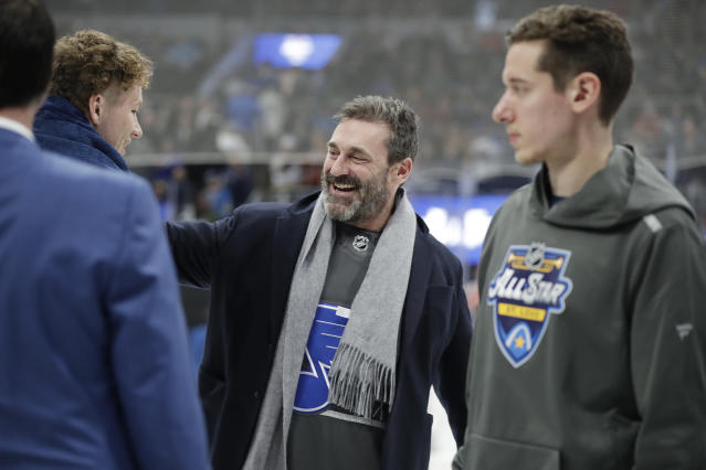 Actor Jon Hamm, center, greets players between NHL hockey All Star games Saturday, Jan. 25, 2020, in St. Louis. (AP Photo/Jeff Roberson)