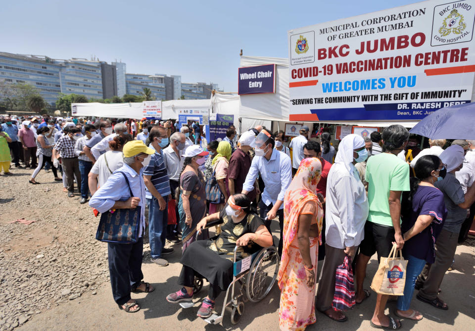 MUMBAI, INDIA - APRIL 24: People wait in a queue to receive a dose of Covid-19 vaccine at BKC Jumbo Covid-19 Vaccination Centre, on April 24, 2021 in Mumbai, India. (Photo by Satish Bate/Hindustan Times via Getty Images)