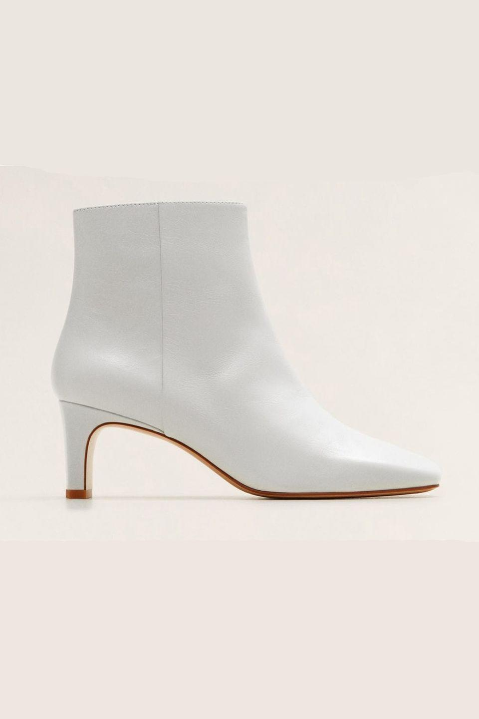 """<p><a class=""""link rapid-noclick-resp"""" href=""""https://go.redirectingat.com?id=127X1599956&url=https%3A%2F%2Fshop.mango.com%2Fgb%2Fwomen%2Fshoes-boots-and-ankle-boots%2Fheel-leather-ankle-boot_43040606.html%3Fc%3D01%26n%3D1%26s%3Dsearch&sref=https%3A%2F%2Fwww.harpersbazaar.com%2Fuk%2Ffashion%2Fshows-trends%2Fg18195015%2Fbest-white-boots%2F"""" rel=""""nofollow noopener"""" target=""""_blank"""" data-ylk=""""slk:SHOP NOW"""">SHOP NOW</a><br></p><p>This offering from Mango looks far more expensive than its price tag.</p><p>Leather boots, £69.99, Mango</p>"""