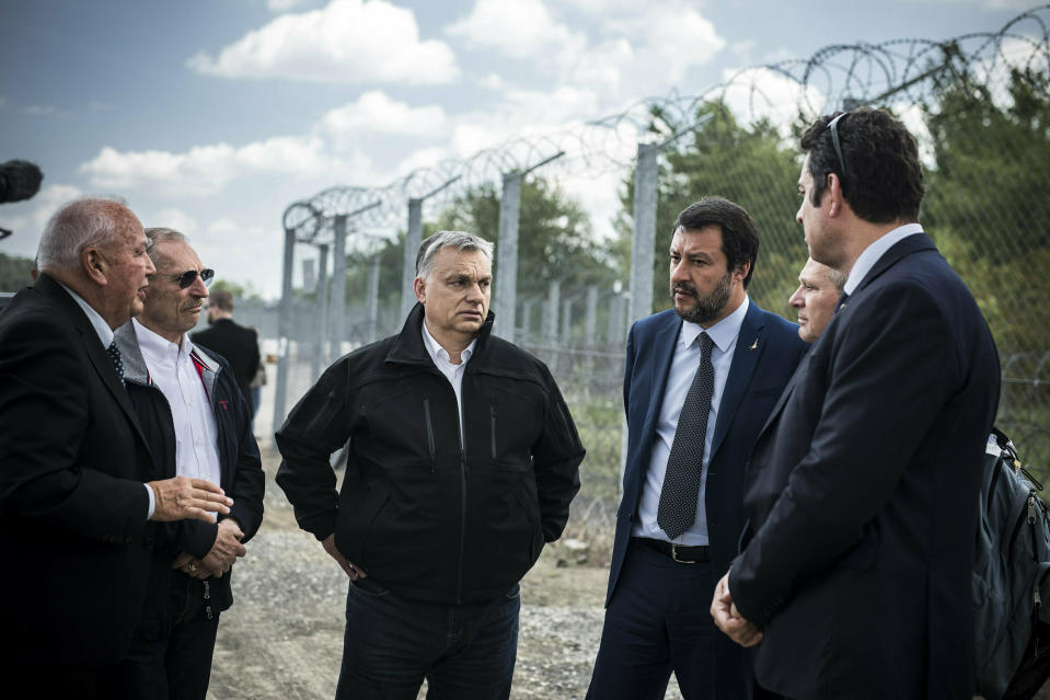 In this handout photo provided by the Hungarian Prime Minister's Press Office shows Hungarian Prime Minister Viktor Orban, center, Italian Interior Minister Matteo Salvini, third right, and Hungarian Interior Minister Sandor Pinter, second left, during their visit at the Hungarian-Serbian border near Roszke, 180 kms southeast of Budapest, Hungary, Thursday, May 2, 2019. (Balazs Szecsodi/Hungarian Prime Minister's Press Office/MTI via AP)