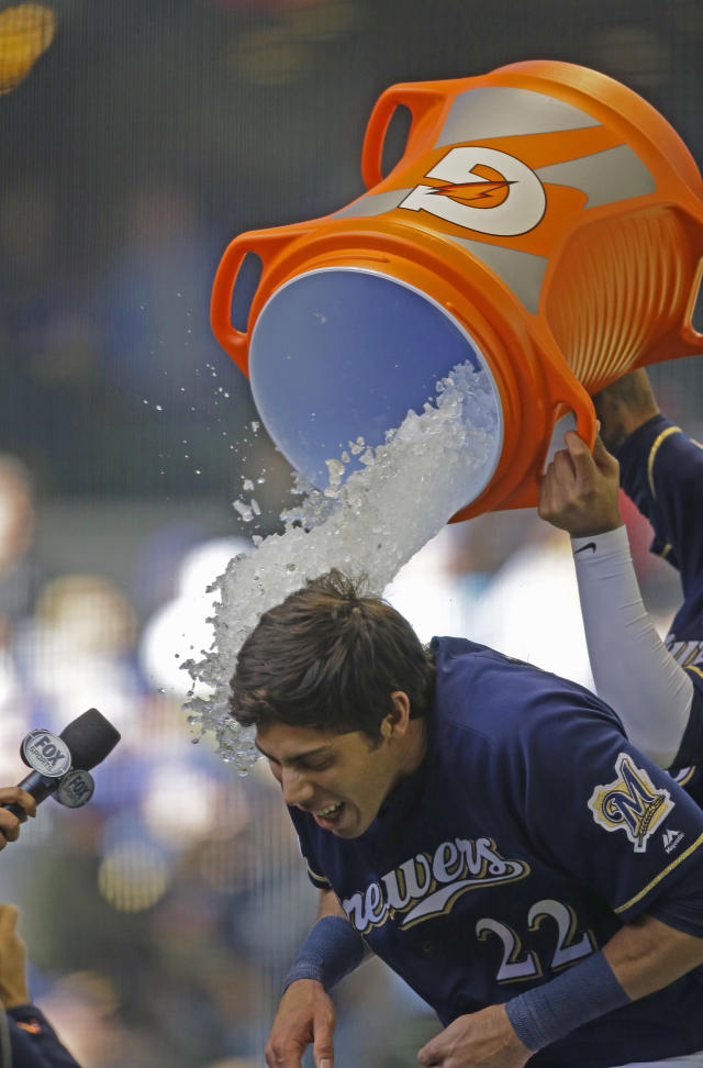 Milwaukee Brewers' Christian Yelich is doused after his winning double against the St. Louis Cardinals during the ninth inning of a baseball game Sunday, March 31, 2019, in Milwaukee. (AP Photo/Jeffrey Phelps)