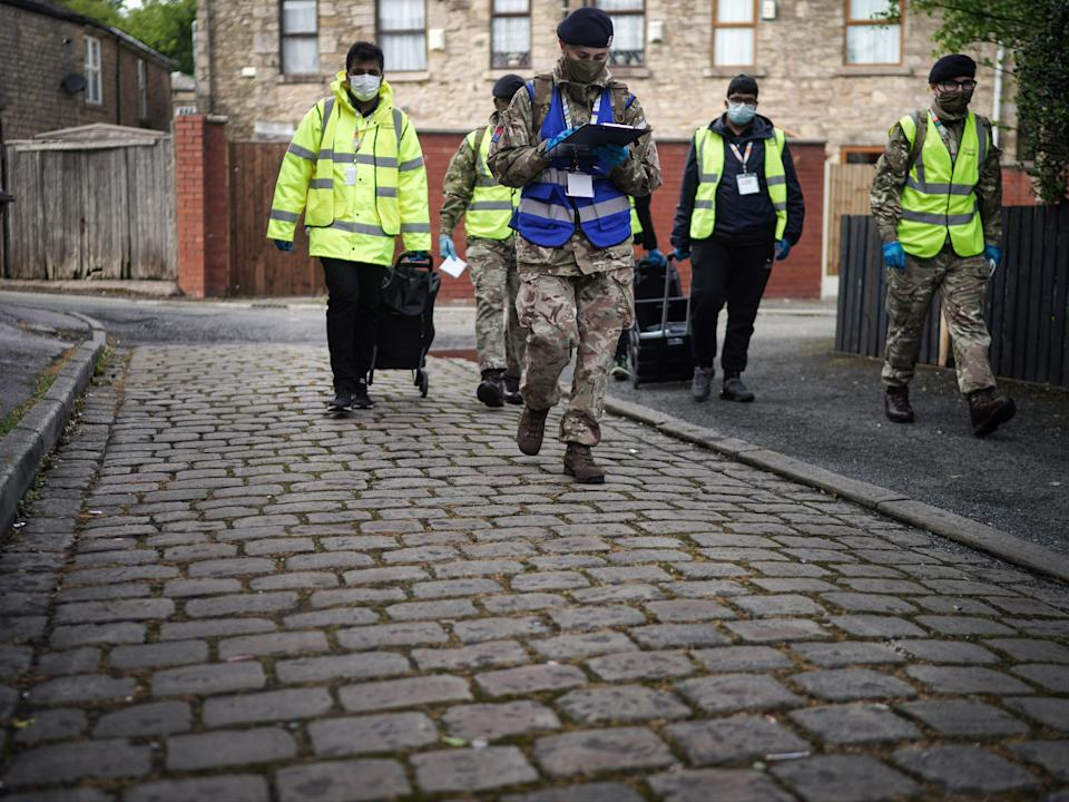 Members of the army help hand out Covid tests in Bolton (Getty Images)