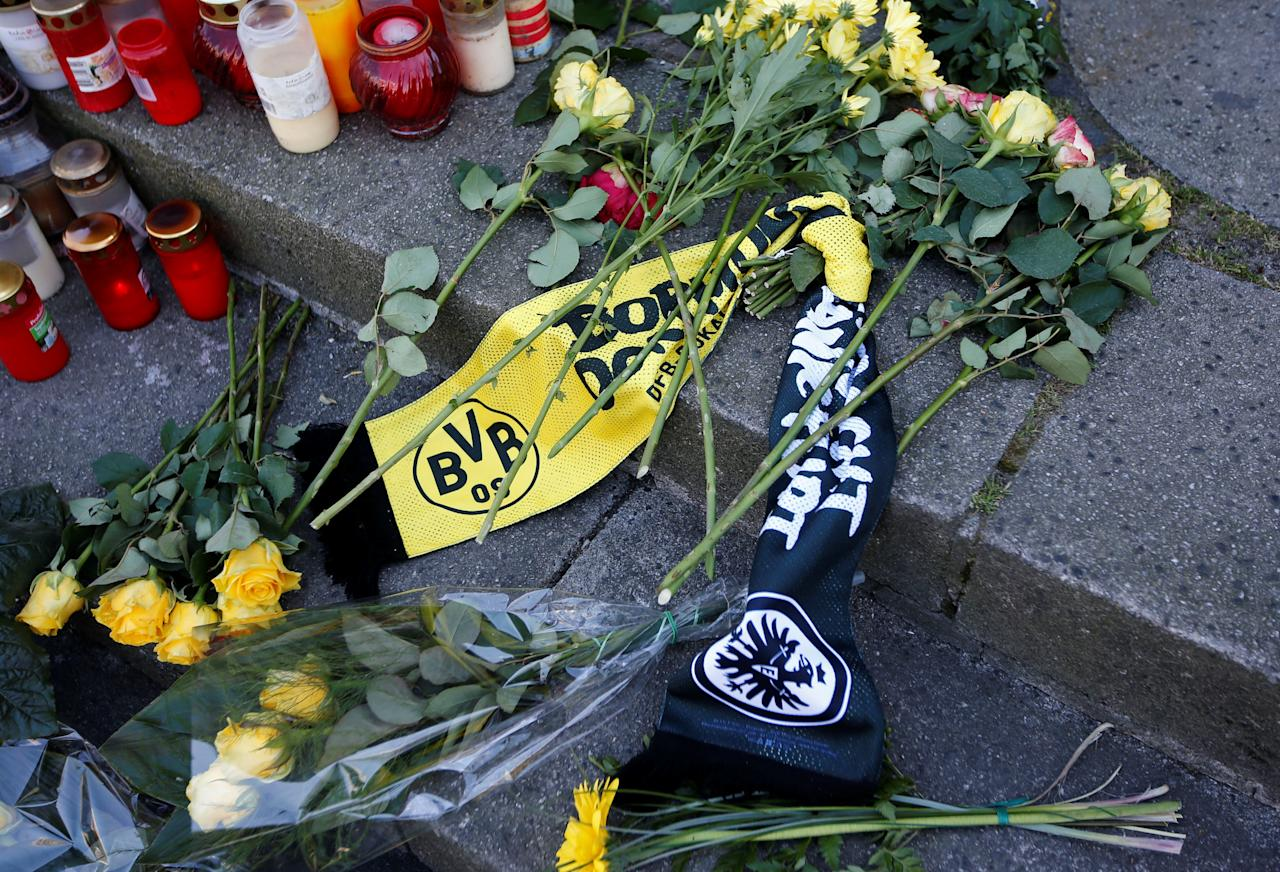 Scarfs of Borussia Dortmund and Eintracht Frankfurt are pictured at the same site where a truck ploughed through a crowd at a Christmas market at Breitscheidplatz square last year, before German Cup final, in Berlin, Germany May 27, 2017. REUTERS/Fabrizio Bensch