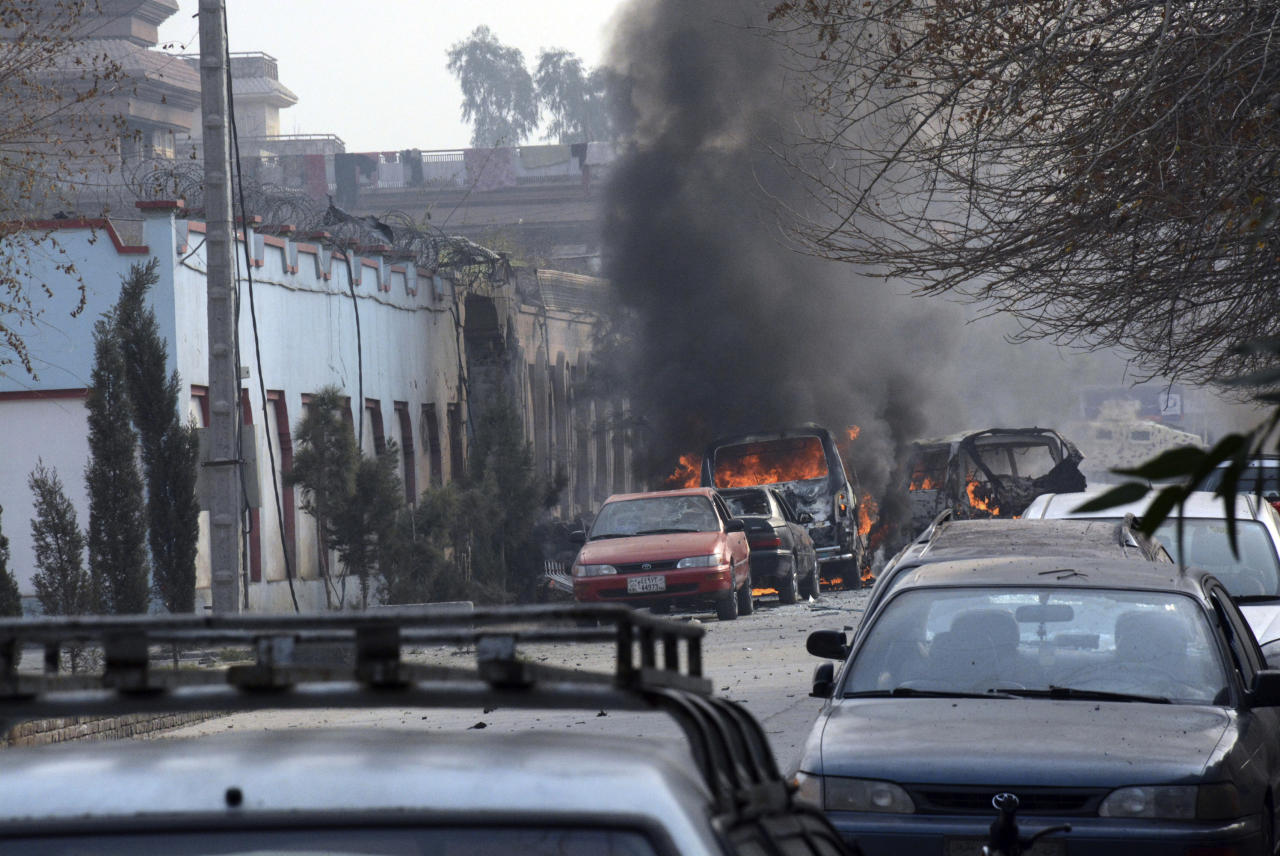 <p>Vehicles burn after a deadly suicide attack in Jalalabad, east of Kabul, Afghanistan, Wednesday, Jan. 24, 2018. Attahullah Khogyani, spokesman for the provincial governor said a group of gunmen stormed the office of the non-governmental organization, Save the Children. (Photo: AP) </p>