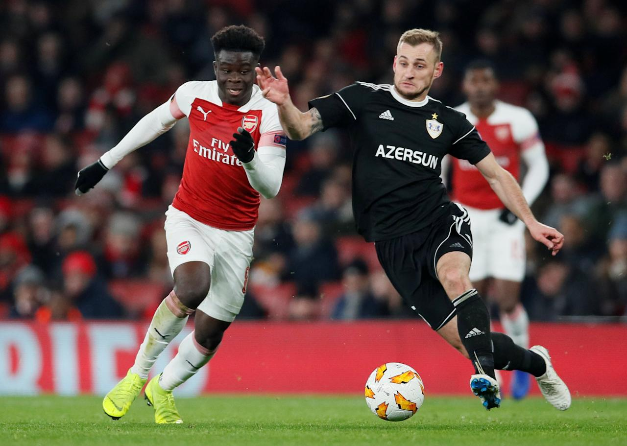 Soccer Football - Europa League - Group Stage - Group E - Arsenal v Qarabag - Emirates Stadium, London, Britain - December 13, 2018  Qarabag's Maksim Medvedev in action with Arsenal's Bukayo Saka         REUTERS/David Klein