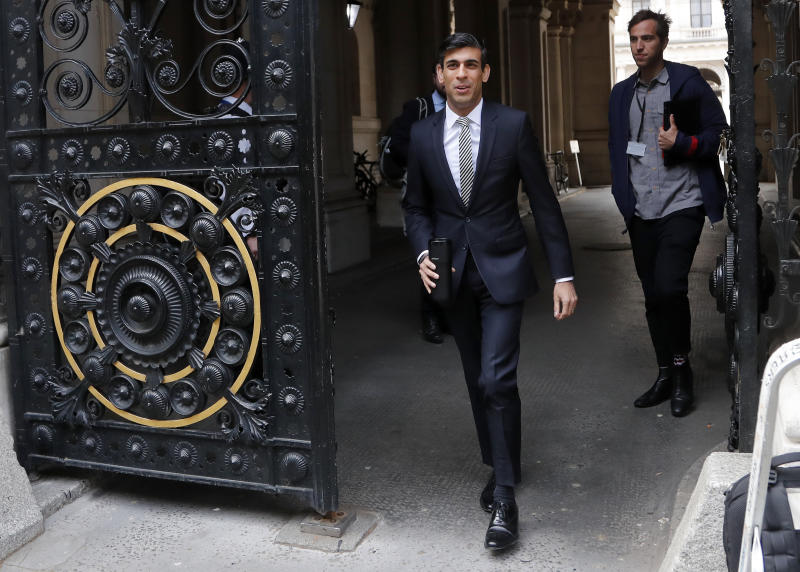 Britain's Chancellor of the Exchequer Rishi Sunak walks to Downing Street in London, Wednesday, May 13, 2020. The British economy shrank 2% in the first quarter of the year from the previous three-month period, the biggest quarterly decline since the global financial crisis of 2008 even though it included just one week of the coronavirus lockdown, official figures showed Wednesday. (AP Photo/Frank Augstein)