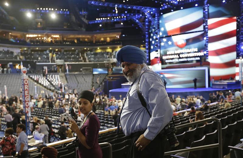 California delegates Harpreet Sandhu from Richmond, right, Kulbir Kaur Bainiwal from Stockton arrive at the Democratic National Convention in Charlotte, N.C., on Tuesday, Sept. 4, 2012. (AP Photo/Charles Dharapak)