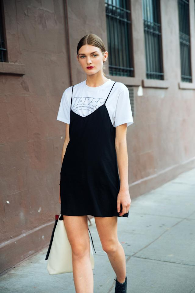 <p>For the most classic of t-shirt and dress looks, throw a black silk slip dress over a vintage printed tee.</p>