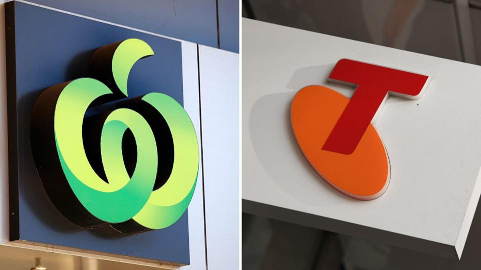 Pictured: Woolworths and Telstra logos. Images: Getty
