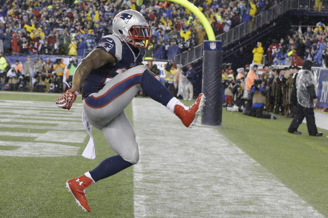 New England Patriots running back Stevan Ridley celebrates his touchdown during the second half of an AFC divisional NFL playoff football game against the Indianapolis Colts in Foxborough, Mass., Saturday, Jan. 11, 2014. (AP Photo/Stephan Savoia)
