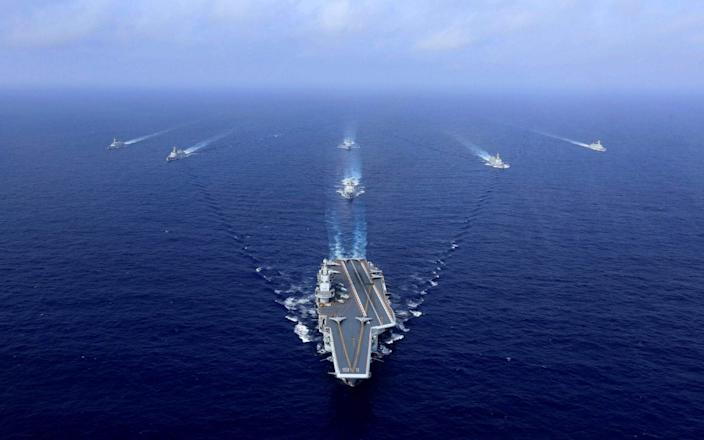 China's aircraft carrier, the Liaoning, sailing during a drill at sea - AFP