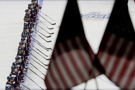 "FILE PHOTO: The U.S. women's national hockey team stands for the national anthem before their ""The Time is Now Tour"" game against Team Canada in Boston, Massachusetts, U.S., October 25, 2017. Ê REUTERS/Brian Snyder/File Photo"