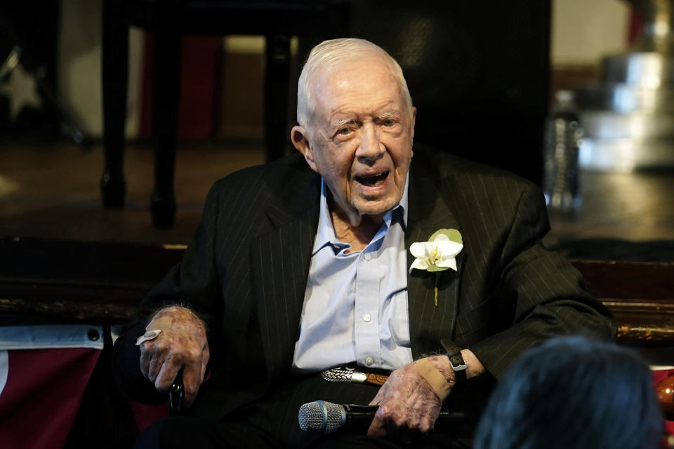 Former President Jimmy Carter reacts as his wife Rosalynn Carter speaks during a reception to celebrate their 75th wedding anniversary Saturday, July 10, 2021, in Plains, Ga.. (AP Photo/John Bazemore, Pool)