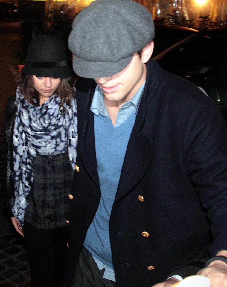 Ashton Kutcher and Mila Kunis share a romantic dinner at Checchino Restaurant in Rome.